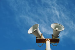 Loudspeaker. Against a blue sky. Concept for communication technlogy royalty free stock photography