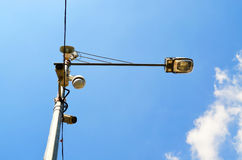Loudspeaker and CCTV camera on lamp post stock image