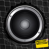 Loudspeaker on grunge background with warning sign Stock Photo