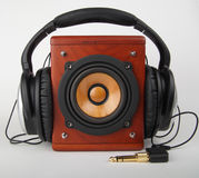 Loudspeaker and headset. Closeup of old loudspeaker and headset Royalty Free Stock Images