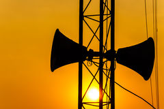 Loudspeaker on pillar and sunset in the evening Royalty Free Stock Image
