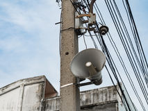 Loudspeaker On Pole. Loudspeaker and electric wire on the pole Royalty Free Stock Photo