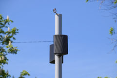 The loudspeaker on the pole. Outdoor speakers for fun walking in the park Stock Photography