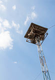 Loudspeaker tower  blue sky background. Royalty Free Stock Images