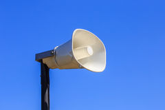 Loudspeaker. White loudspeaker on stand against blue sky Royalty Free Stock Image