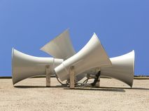 Loudspeakers. A group of loudspeakers on a wall Royalty Free Stock Photos