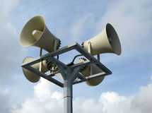 Loudspeakers against blue sky Stock Image