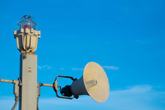 Loudspeakers and alarm lamp are installed on column Royalty Free Stock Images