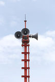 Loudspeakers broadcast alarms. Loudspeakers broadcast alarms on outdoor sky background royalty free stock image