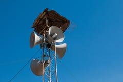 Loudspeakers broadcast. Blue sky background stock photo