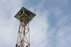 Loudspeakers broadcast tower with a blue sky background. Loudspeakers broadcast tower with a blue sky Royalty Free Stock Photo