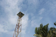 Loudspeakers broadcast tower with a blue sky background Stock Photo