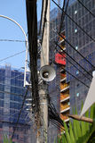 Loudspeakers on electric post. Pair of loudspeakers to make announce to citizen from ward at Ho Chi Minh city on day, speaker hang on electric post with Stock Images