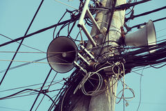 Loudspeakers on electric post. Pair of loudspeakers to make announce to citizen from ward at Ho Chi Minh city on day, speaker hang on electric post with Royalty Free Stock Image
