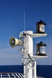 Loudspeakers and Lanterns on Ship Mast Stock Photo
