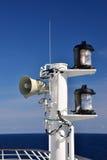 Loudspeakers and Lanterns on Ship Mast. Loudspeakers and lanterns on a large ship's communication mast stock photo