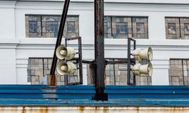 Loudspeakers on Old Warehouse Stock Images