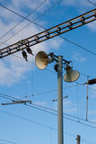 Loudspeakers on pylon. Two loudspeakers on pylon, the traction on background Stock Photography