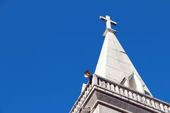 Loudspeakers on tower of church on blue sky. Loudspeakers on tower of church on blue sky with copy space, announce from Christ Church royalty free stock image