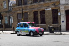 louez son taxi de Londres de lumière tourné Photo stock