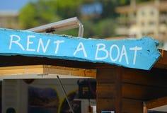 LOUEZ un signe en bois de BATEAU photographie stock