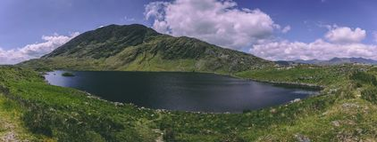 Lough Barfinnihy lake at Healy Pass, a 12 km route through the borderlands of County Cork and County Kerry Stock Images