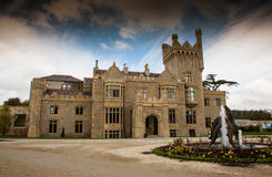 Lough Eske Castle, Donegal, Ireland. Exterior of Lough Eske Castle with fountain on grounds in Donegal, Ireland on sunny day Royalty Free Stock Photo