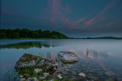 Lough Gur 19-06-2017. Lough Gur Irish: Loch Gair is a lake in County Limerick, Ireland between the towns of Herbertstown and Bruff. The lake forms a horseshoe Stock Photography