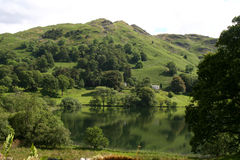 Loughrigg Fell and Tarn. Beautiful Loughrigg Tarn in The English Lake District National Park Royalty Free Stock Photos