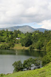 Loughrigg Tarn. Beautiful Loughrigg Tarn in The English Lake District National Park with the Langdale Peaks in the Distance Stock Photos