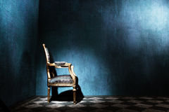 Louis style armchair in blue room Royalty Free Stock Photo
