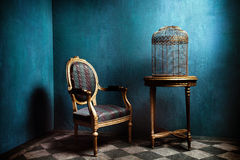Louis Table, Armchair And Old Golden Bird Cage Stock Image