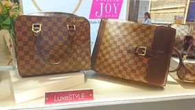 Louis Vuitton bags. On display at a pre-own reseller store in Singapore Royalty Free Stock Photography