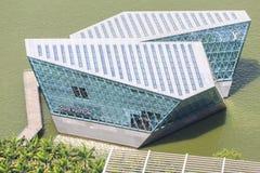 A Louis Vuitton boutique extends out into Marina Bay. Stock Photos