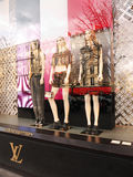 Louis Vuitton display Champs Élysées Paris. A display of the Louis Vuitton boutique with three female mannequins. One can see the famous Fouquet's restaurant Royalty Free Stock Photo