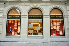 Louis Vuitton fashion boutique in Italy. Louis Vuitton boutique in Florence city , Italy . The label is well known for its LV monogram, which is featured on Stock Photos
