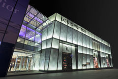 Louis Vuitton outlet at night, Dalian, China. DALIAN-CHINA-NOV. 7. Louis Vuitton routinely ranks among the most admired brands in surveys of Chinese consumers Stock Photo