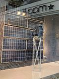 Louis Vuitton window Display with Solar panels powering display. Honolulu - May 31, 2018: Louis Vuitton window Display with Solar panels powering display. Louis royalty free stock photo