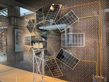 Louis Vuitton window Display with Solar panels powering display. Honolulu - May 31, 2018: Louis Vuitton window Display with Solar panels powering display. Louis stock photo