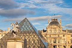 Louis XIV statue in front of Louvre Royalty Free Stock Photo