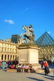 Louis XIV statue at the Louvre museum in Paris, France Royalty Free Stock Image
