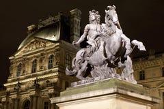 Louis XIV staty på Louvre i Paris Fotografering för Bildbyråer
