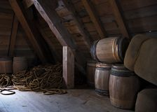 Louisbourg. Interior of a historic building, with storage barrels and rope royalty free stock image