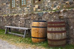 Louisbourg. A bench and two barrels along side stone walls stock photo