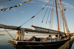 LOUISBOURG, CANADA - August 13, 2016:. Bluenose II is a replica of the famous fishing schooner Bluenose. It`s docked in Louisbourg as part of its summer sailing Stock Photos