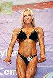 Louise Rogers. UK physique standout, Louise Rogers poses in the Bodyfitness competition at the IFBB World Championships in Cernobbio, Italy, on October 17, 2009 Stock Image