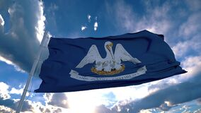Louisiana flag on a flagpole waving in the wind in the sky. State of Louisiana in The United States of America
