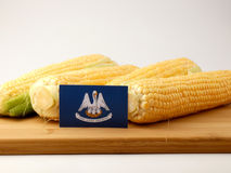 Louisiana flag on a wooden panel with corn isolated on a white b stock images