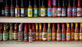 Louisiana Hot Sauce's. Shelves of different kinds of Louisiana hot sauce's useful for doing articles on Louisiana foods Royalty Free Stock Images