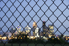 Louisville Blur. With a focus on fence royalty free stock image